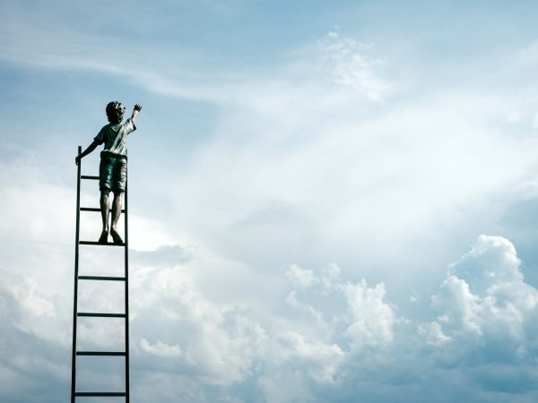 Boy on ladder showing blue sky thinking in Breakfast Town blog on launching a brand